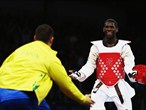 Anthony Obame of Gabon celebrates with his coach