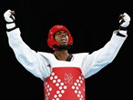 Lutalo Muhammad of Great Britain celebrates winning the bronze medal