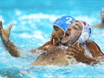 Niksa Dobud of Croatia and Amaurys Perez of Italy tussle in the men's Water Polo gold medal match