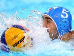 Alex Giorgetti of Italy swims with the ball during the men's Water Polo gold medal match