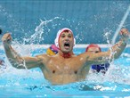 Nikola Janovic of Montenegro celebrates a goal during the men's bronze medal match