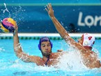 Vanja Udovicic of Serbia is challenged by Antonio Petrovic of Montenegro
