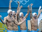Italian players celebrate winning the Men's Water Polo semi-final match