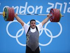 Sajjad Anoushiravani Hamlabad of Iran competes in the men's +105kg Weightlifting final