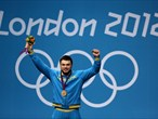 Gold medallist Oleksiy Torokhtiy of Ukraine poses on the podium