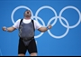 Sajjad Anoushiravani Hamlabad of Iran celebrates a succesful lift on his way to silver in the men's +105kg Weightlifting final