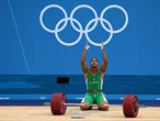 Walid Bidani of Algeria competes in the men's 105kg weightlifting