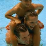 Family in swimming pool
