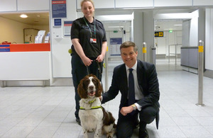Mark Harper with detection dog Roddy and Border Force's Rachel Albery