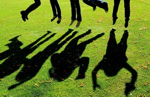 Shadows of people jumping in the air