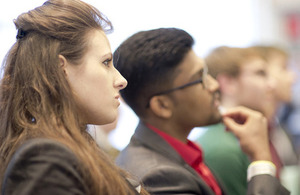 Young people listen to a careers talk.