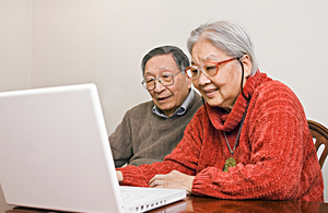 elderly couple on a computer