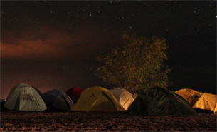 An image of camping under the stars