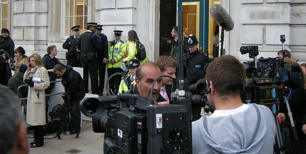 Exterior of Cabinet Office with cameras and journalists
