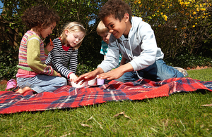 children playing on a blanket