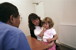 Mother and daughter in GP surgery