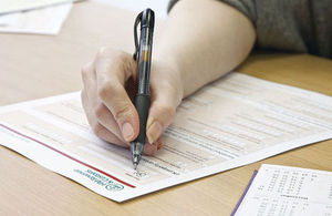 Person filling in a tax form