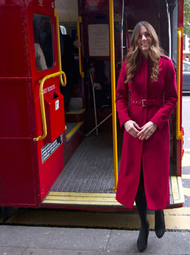 The Duchess of Cambridge stepping off a 1960s Routemaster bus at High Street Kensington station in London where they met military personnel and volunteers supporting London Poppy Day