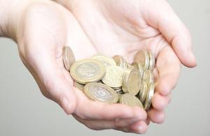 Pound coins in hands