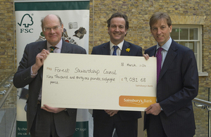 Nick Clegg presenting cheque to Forest Stewardship Council.