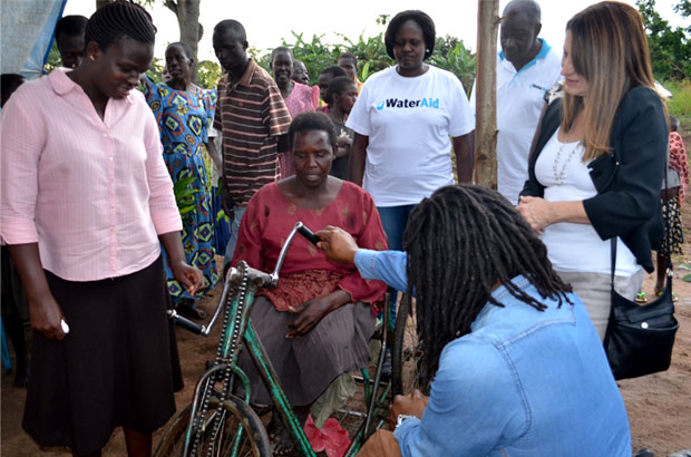 In Bobobe village, Uganda, Lynne Featherstone and Ade Adepitan met with Margaret - a disabled mother who gets around with the aid of her improvised wheelchair. Picture: James Kiyimba/WaterAid