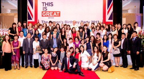 All staff of the UK's family in Vietnam celebrate the Queen's Birthday Party in Hanoi on 25 June 2013.