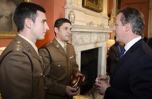 Prime Minister David Cameron talking to flood volunteers.