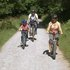 Family cycling along forest trail © John McFarlane / Forestry Commission