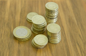 Pound coins on table