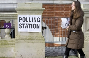 Woman walking to a polling station.
