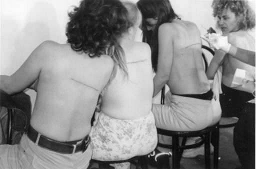 Santiago Sierra, '160 cm Line Tattooed on 4 People El Gallo Arte Contemporáneo. Salamanca, Spain. December 2000' 2000