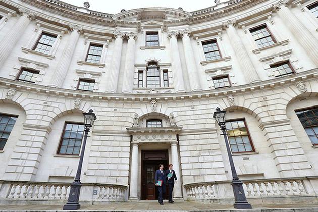 George Osborne and Danny Alexander leaving the HM Treasury building.