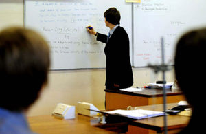 Teacher writing on a white board
