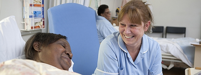 female doctor patient laughing