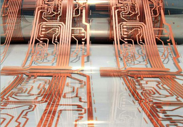 Lines of copper printed on a roll of transparent plastic.