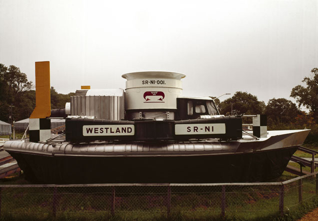 Photograph of a hovercraft painted black and silver, with 'Westland SR-N1' displayed on its side.