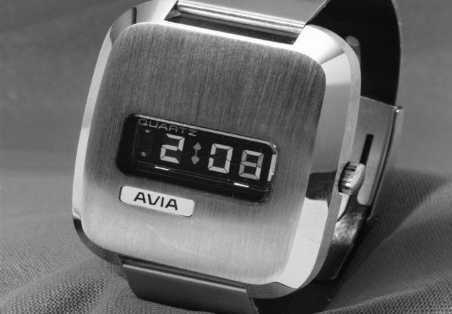 Close-up of a digital watch with a metallic casing.