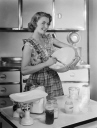 Woman holding a mixing bowl, 1952