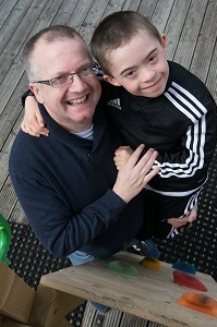 Picture of Adam, who was supported by the Foyle Down Syndrome Trust