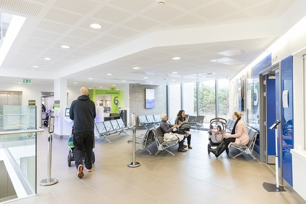 People in hospital waiting area